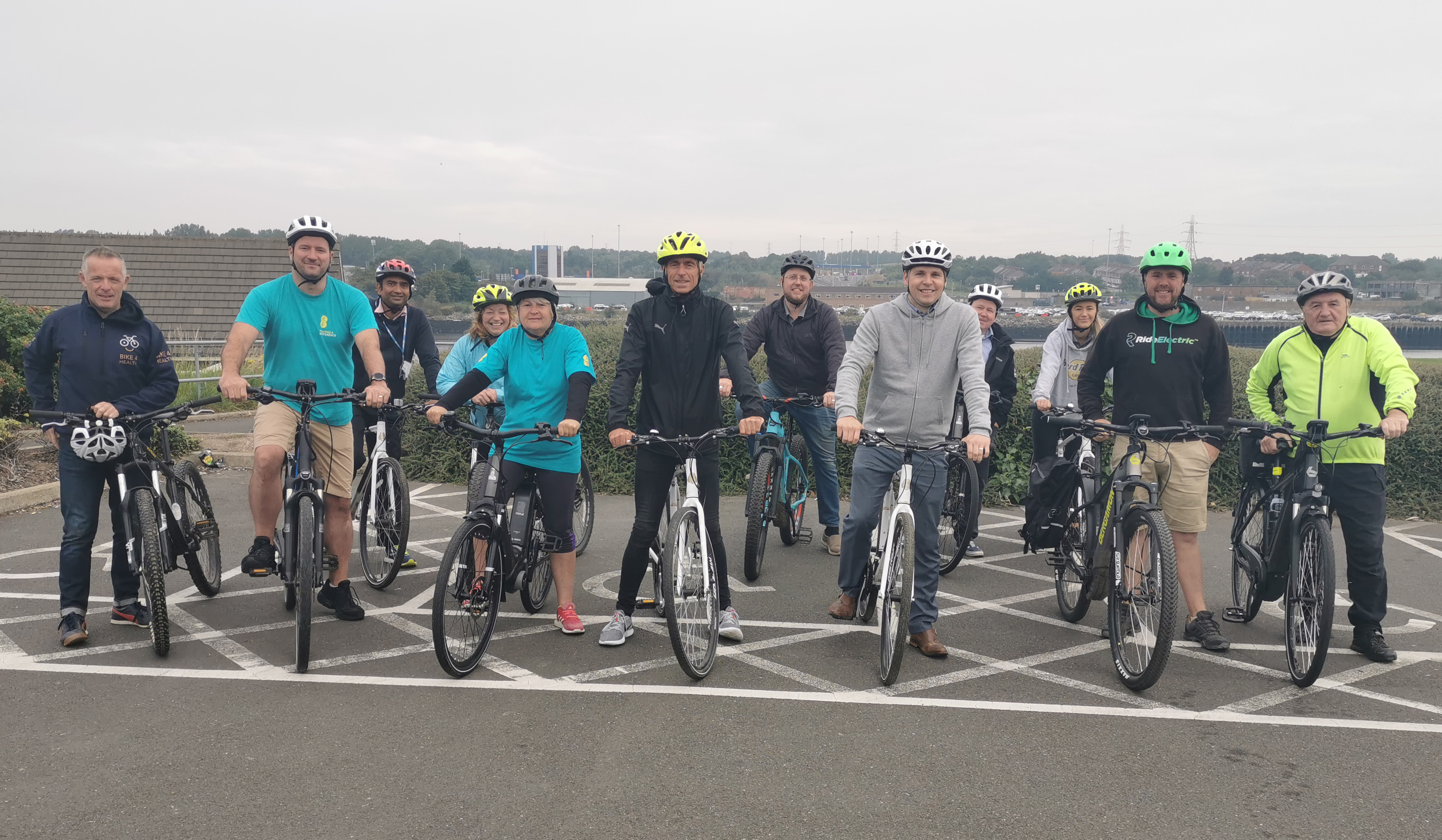 Cobalt business leaders get on 2 wheels to celebrate Pedestrian & Cyclist tunnel launch